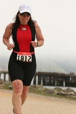 Coach Suzanne running on Baker Beach in San Fransisco Bay