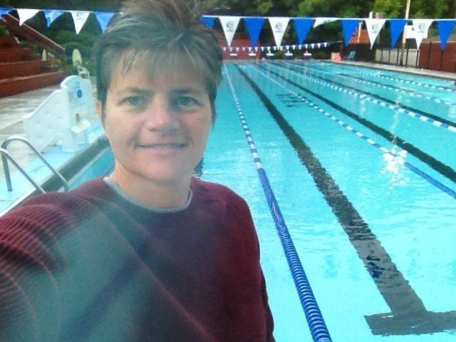 Coach Suzanne selfie at the side of the pool.